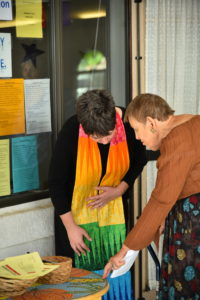 Sharon welcoming a congregant